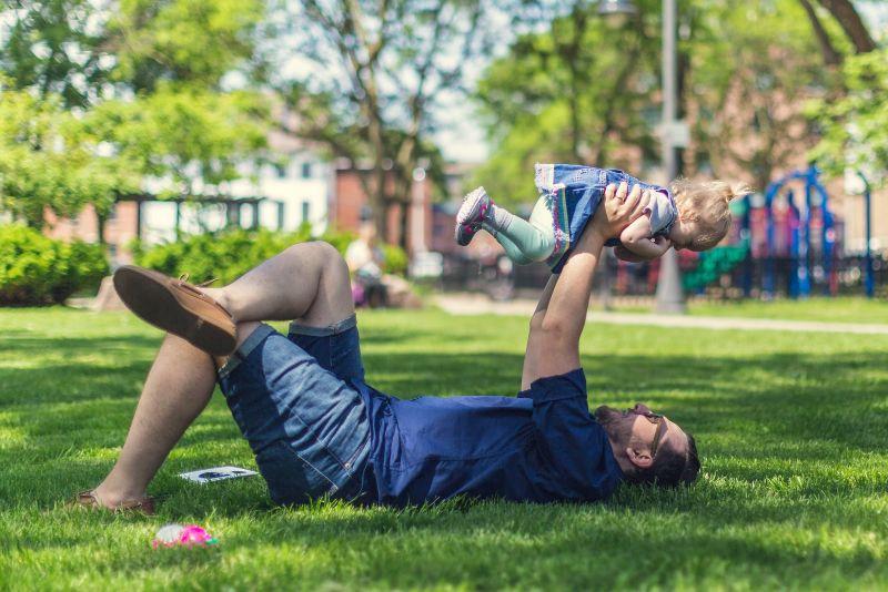 dad having fun with daughter